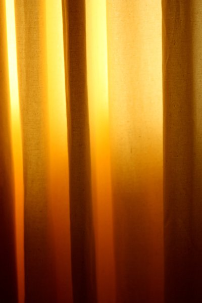 Curtain: the sun shining through a curtain