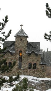 "American Cathedral 5: A beautiful little Catholic church near Estes Park Colorado. I saw a sign marking it as ""historical"" which means it's probably 100 years old or so. I took this on March 9, 2008- a Sunday. I could hear their choir while running around outside."