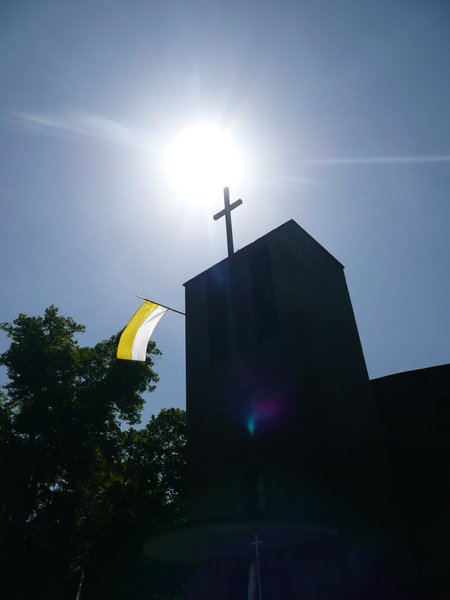 Holy Cross: Cross of catholic church in Hamburg in the sun.