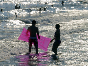 Pink: Pink airbed upon waves in adverse light