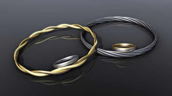 Jewellery: bracelets and rings: An abstract picture of 2 bracelets and 2 rings with multiple colors of gold and special metal on a dark background