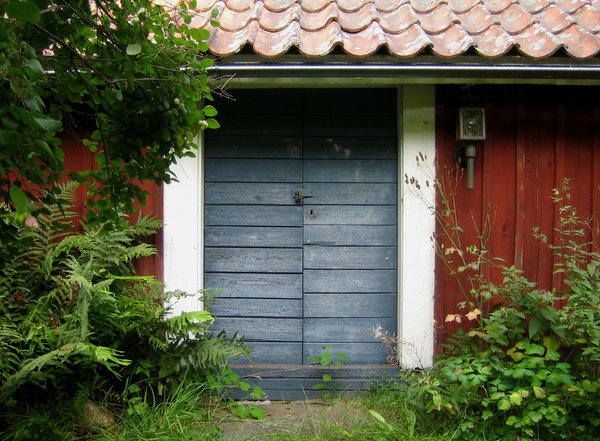 Blue door: A door of the annex of an old farmhouse in Sweden