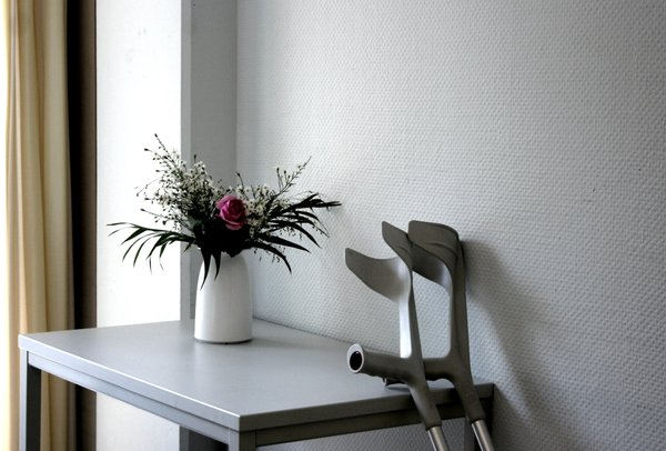 hope: room in a hospital with flower and crutches