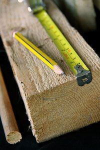 Woodwork: Sawn wood with pencil and steel measure