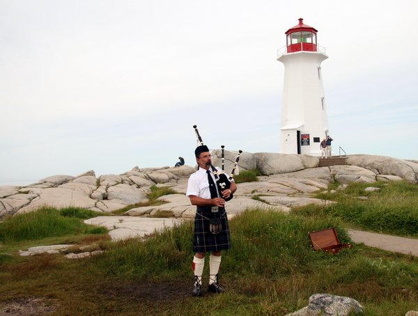 Bag Piper at Cove: Bag Piper at Peggy's Cove, Nova Scotia, Canada