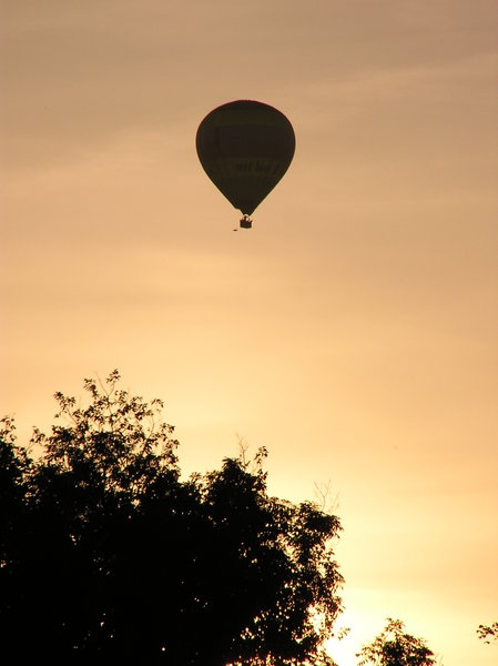 Balloon against orange sky
