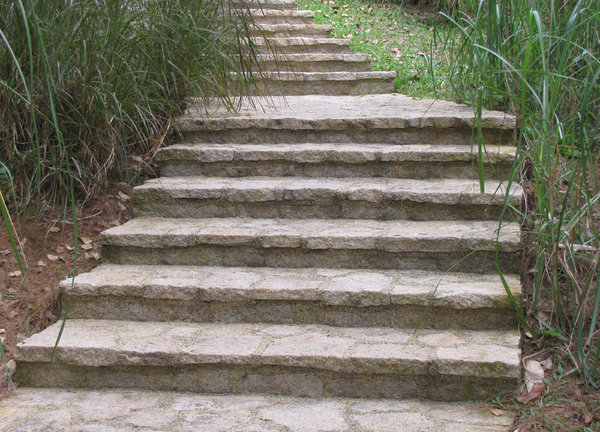 stepping up: concrete and stone steps curving up