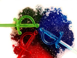 RGB - dyed sugar and swords: Dyed sugar in red, green and blue colors and matching plastic swords