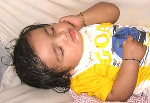 Baby: An 8-month old sleeping baby.