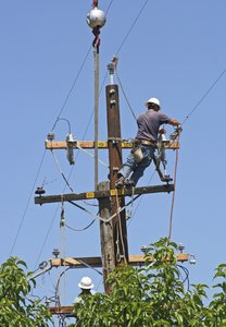 Men Replacing Power Pole