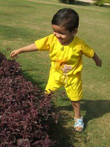 Child 2: A 2-year old Indian boy playing in a park.