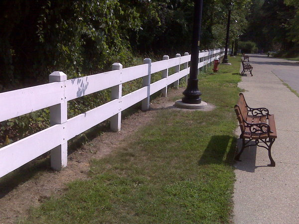 white fence and park bench
