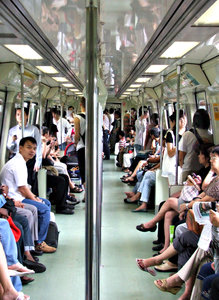 train trip: passengers travelling on mass rapid transit train in Singapore