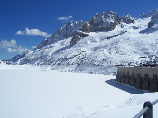 LAKE AND SNOW: Fedaia Lake on Dolomiti. this bridge was the movie set of
