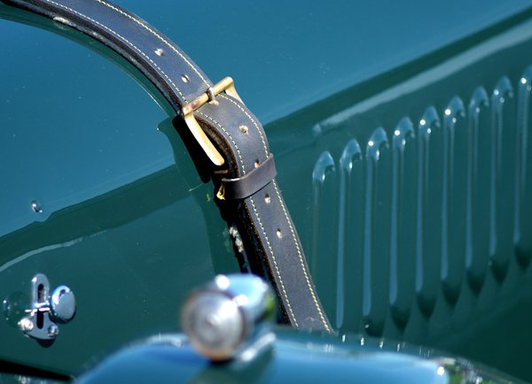 Leather strap on hood: Classic sportscar with leather strap to hold the hood/bonnet.