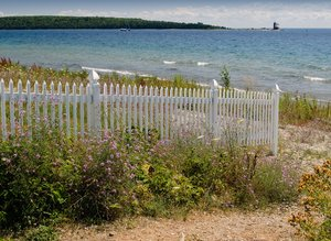 Picket fence on beach