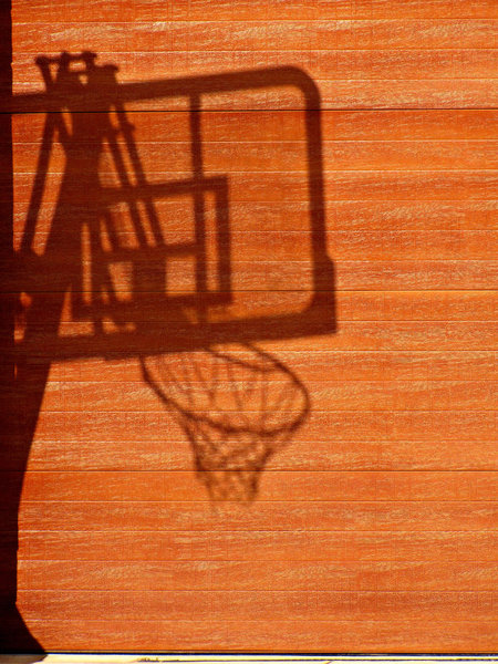 shadowy game: shadow of mobile basketball board and hoop/basket