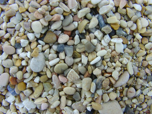 At the beach (pebbles become s