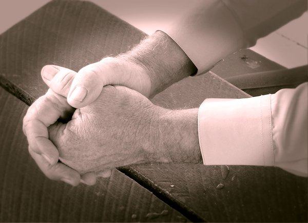 Praying Hands 3: A man's hands clenched in prayer. Duotone.