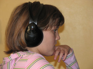 listen carefuly: girl listening through headphones