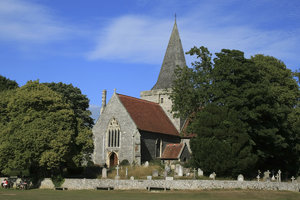 Sussex church: A church and graveyard wall constructed of flint cobbles in East Sussex, England.