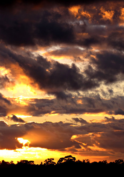 sombre southern sunset series: approaching storm clouds in Southern skies with brilliant setting sun
