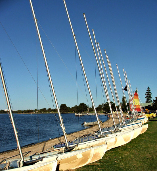 waiting in line: catamarans lined up for hire for recreational river sailing