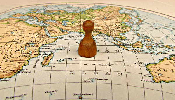 alone in the world: single piece on world map symbolizing aloneness - isolation - loneliness
