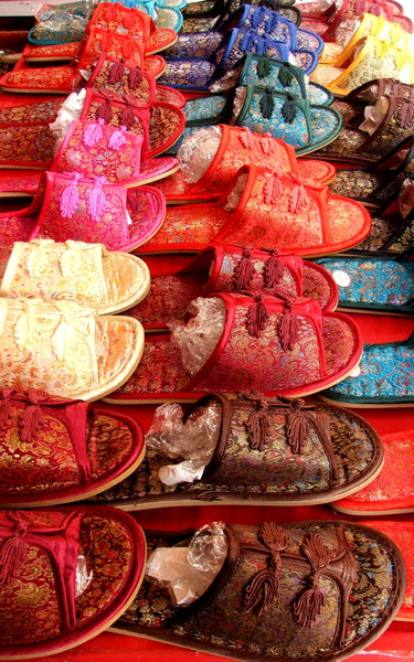 colourful slipper sale: sale display of soft fabric colourful Chinese slippers