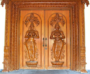 side entrance: Hindu temple side entrance for temple staff with carved decorated doors