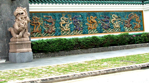 dragon walk wall: glazed tiled wall depicting five-toed dragons plus guardian lion-dog