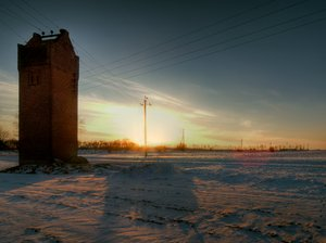Transformerstation - HDR: A transformer station in a snowy, rural scenery.