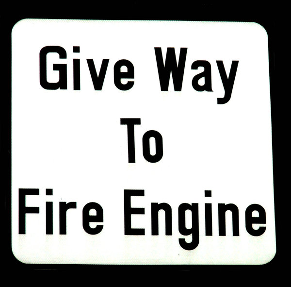 fire engine first: warning sign to give way for emerging fire engines