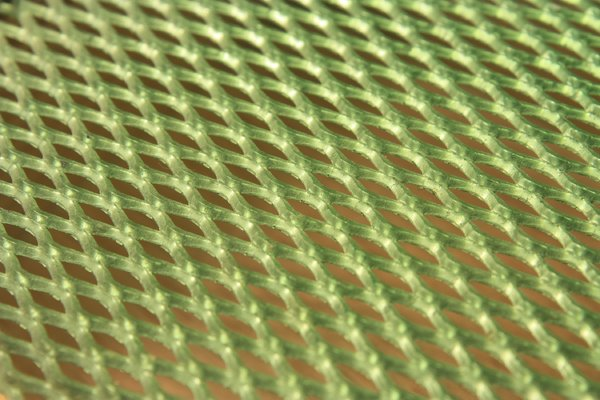 Green lattice: Macro shot of a green metal lattice