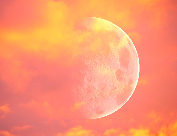 Giant Moon 4: A giant moon in the evening sky with sunset colours.