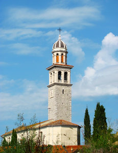 Italian church: rural church tower on a summers day in Friuli-Venezia Giulia, by the roadside between Monfalcone and Grado