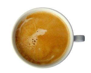 Coffee with crema 1: isolated coffee cup view from above