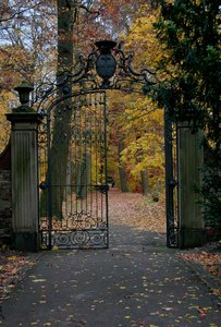 autumn: ancient door in the park of the castle of Karlsruhe/Germany