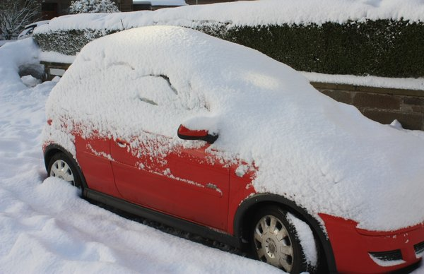 Snow covered cars: Snow covered cars