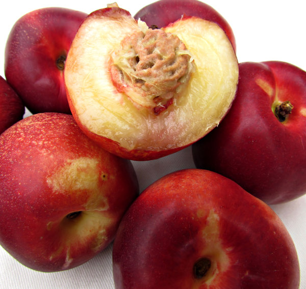 ripe nectarines: selection of fresh nectarines - stone fruit related to peaches