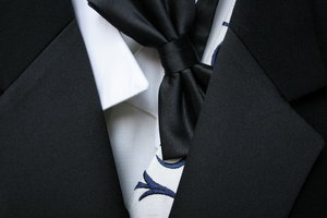 Tuxedo and Tie: Close-up of formal evening wear with tuxedo and bow tie