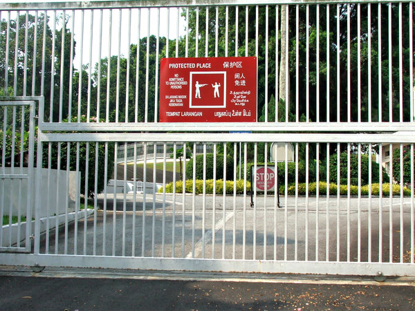 serious warning & barred: warning sign prohibiting entry on securely closed gates