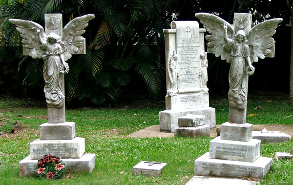 angels watching over: winged graveside angels looking down