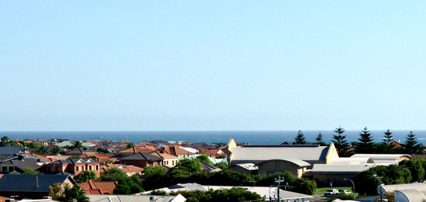 rooftop views: ocean suburb seen across rooftops