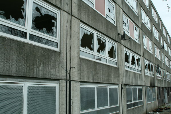 broken: broken windows from a block of flats that are getting knocked down,