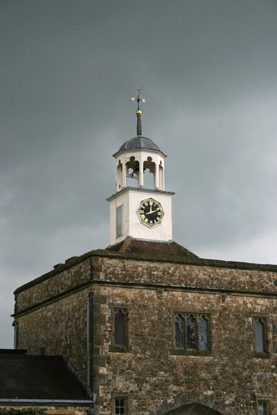 Clock tower: Clock tower of a manor house in West Sussex, England.