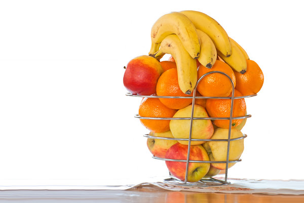 Fruit basket: fruit basket against orange and white background