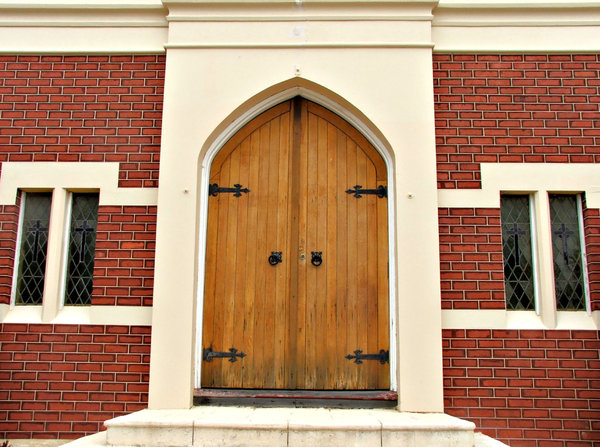 closed doors: closed doors of renovated historic old church building