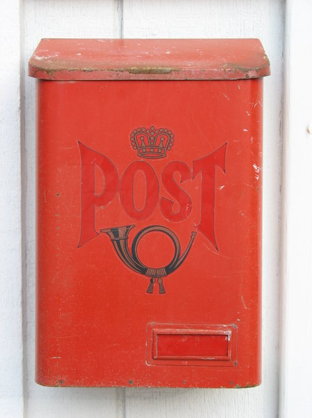 post box: a classic red post box.