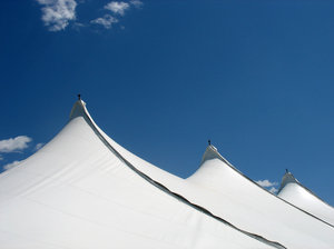tent: three peaks of a tent and a clear blue sky.